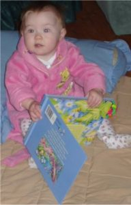 Already she knows that books bring pleasure